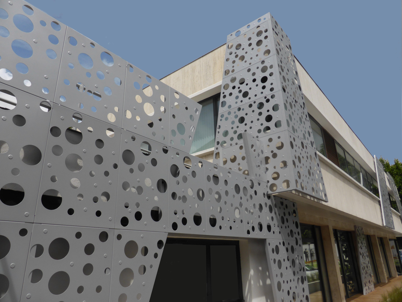 Fa ades for Laser sur facade